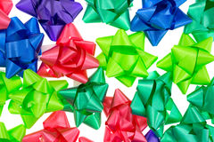 Christmas bows. Several shades of Christmas bows atop a white background Stock Photography