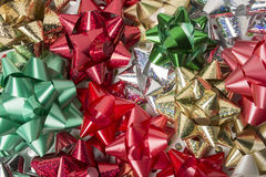 Christmas Bows. Various Christmas Bows scattered on wrapping paper Royalty Free Stock Image