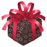 Christmas box. Brown christmas box with white strs and a red satin bow Royalty Free Stock Images