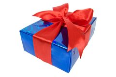 Christmas box in blue film wrap with red ribbon Stock Images