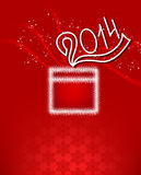 Christmas box with a bow and an inscription 2014. On a red background with snowflakes and sparkles Stock Image