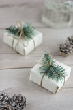 Christmas box. Boxes with Christmas presents on wooden surface against defocused lights Stock Photography