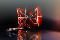Christmas box by the candle light. Macro view Royalty Free Stock Images