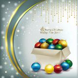 Christmas box with colored balls on a bright background Royalty Free Stock Photography