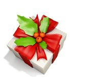 Christmas box decorated by holly berry Stock Photography
