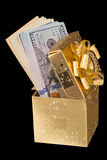 Christmas box with dollars Royalty Free Stock Images