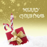 Christmas box gift with greeting on gold snowflake Royalty Free Stock Photo