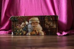 A christmas box with gift and santa claus. Box with gift and santa claus royalty free stock photo