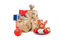 Christmas box gifts isolated on white. Concept with money, santa cap. Stock Photo