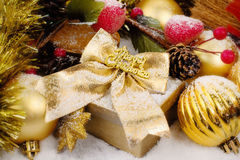 Christmas box with golden decorations Stock Images
