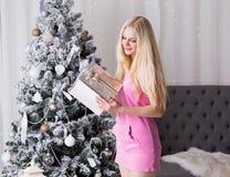 Christmas box, pink dress, fun Royalty Free Stock Photos