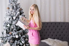 Christmas box, pink dress, fun Royalty Free Stock Images