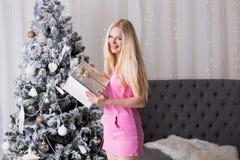 Christmas box, pink dress, fun Stock Images