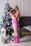 Christmas box, pink dress, fun Royalty Free Stock Photo