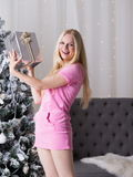 Christmas box, pink dress, fun Royalty Free Stock Photography