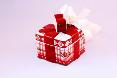 Christmas box. With red ceramic ribbon on white background and also with white sateen ribbon royalty free stock image