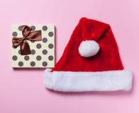 Christmas box and Santa Claus hat Royalty Free Stock Photos