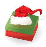 Christmas box and santa hat. Stock Photo