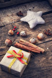 Christmas box and spices Royalty Free Stock Photo