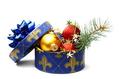Christmas box with tinsel and balls. Royalty Free Stock Images