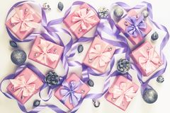 Christmas boxes with gifts on the occasion of pink color on white background cones nuts decor Top view flat lay horizontal. Christmas boxes with gifts on the stock photo