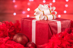 Christmas Boxes and Ornaments - over red feathers Royalty Free Stock Images