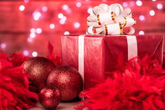 Christmas Boxes and Ornaments - over red feathers Royalty Free Stock Photos