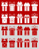 Christmas boxes with patterns. Christmas boxes: boxes isolated on the red background and cut boxes on the grey background. Set of 10 Christmas boxes with Royalty Free Stock Photography