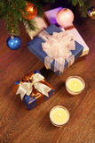 Christmas boxes with two candle Royalty Free Stock Photo