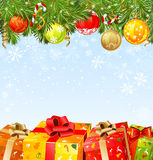 Christmas boxes under a fir-tree. Four  Christmas gifts under a fir-tree Royalty Free Stock Image