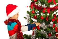 Christmas boy decorate tree Stock Photos