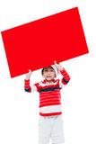 Christmas boy with empty banner Stock Images