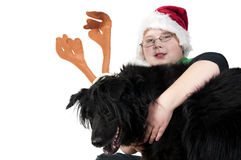 A Christmas boy and his reindeer dog Royalty Free Stock Image