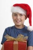Christmas boy holding present royalty free stock photo