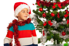 Christmas boy looking away. And dreaming with open eyes Stock Photography