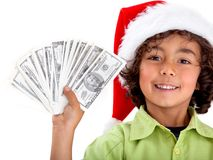 Christmas boy with money Royalty Free Stock Photo