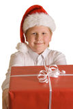 Christmas boy with a present. Christmas dressed boy with a present - box wrapped in red paper Royalty Free Stock Images
