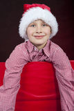 Christmas boy in present box. Smiling christmas boy in present box Stock Photo