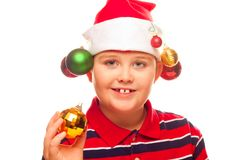 Christmas boy with santa hat Royalty Free Stock Images