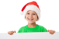 Christmas boy standing with empty banner Royalty Free Stock Photography