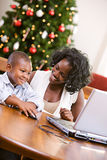 Christmas: Boy Using Computer Mouse Royalty Free Stock Image