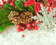Christmas branch of berries with a silver decorati Stock Photo