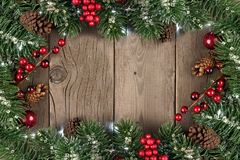 Christmas branch frame on rustic old wood Royalty Free Stock Photography
