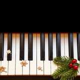 Christmas branch on piano Stock Image