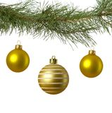 Christmas branch with three golden baubles Stock Photos