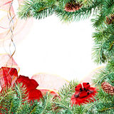Christmas branches frame. Christmas pine branches with a red bow and present on a white background royalty free stock photo