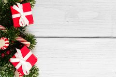 Free Christmas Branches, Gifts And Candy Canes Border On White Wood Stock Photography - 61719592