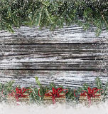 Christmas branches on wood Royalty Free Stock Image