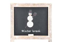 Christmas break with snowman on blackboard Stock Images