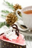 Christmas breakfast. Delicious raspberry souffle cake and cup of tea on Christmas morning Royalty Free Stock Photo